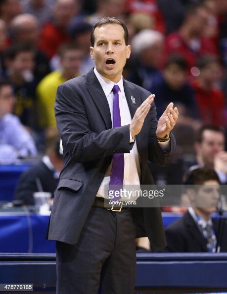 Chris Collins the head coach of the Northwestern Wildcats gives instructions to his team in the game against the Michigan State Spartans during the...