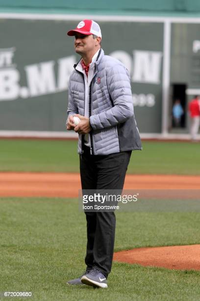 Chris Combs of NC State who was diagnosed with ALS throws out the first pitch before the start of a regular season college baseball game...