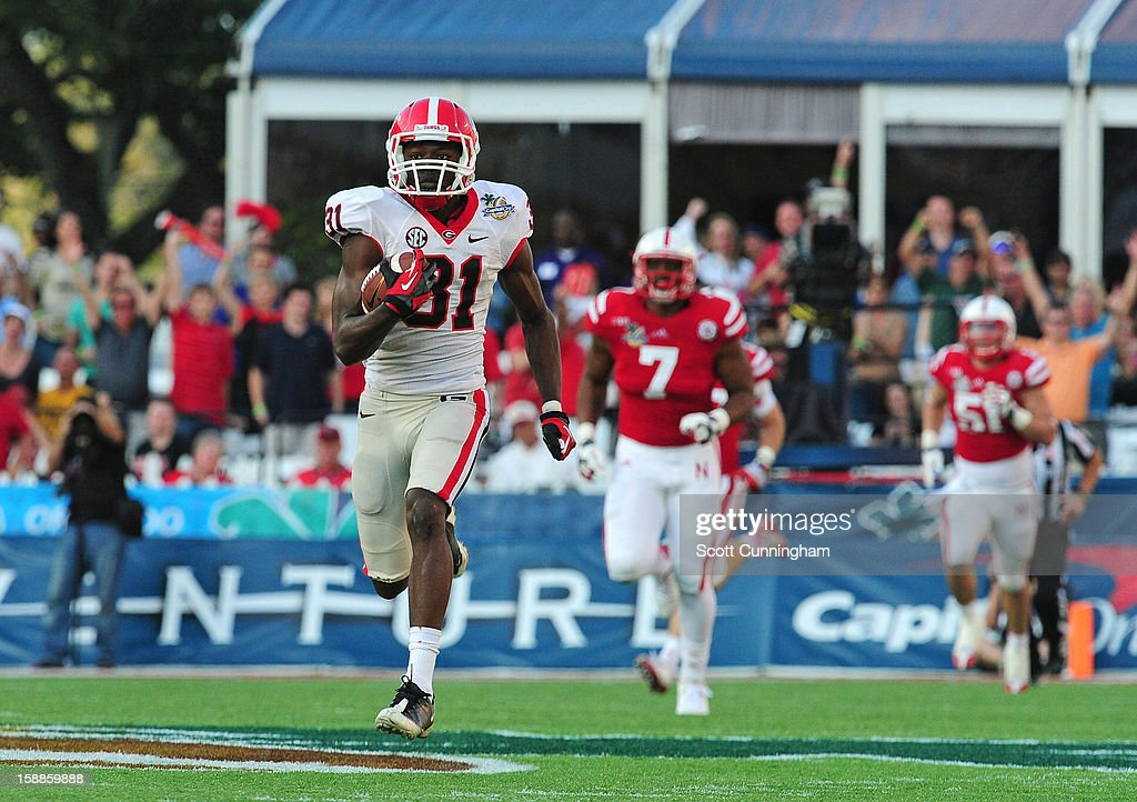 Chris Conley #31 of the Georgia Bulldogs scores on an 87 yard reception against the Nebraska Cornhuskers during the Capital One Bowl at the Citrus Bowl on January 1, 2013 in Orlando, Florida.