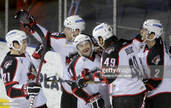 Chris Conner of the Pirates center is congratulated by teammates after scoring a goal in the first period of a game against the Manchester Monarchs...