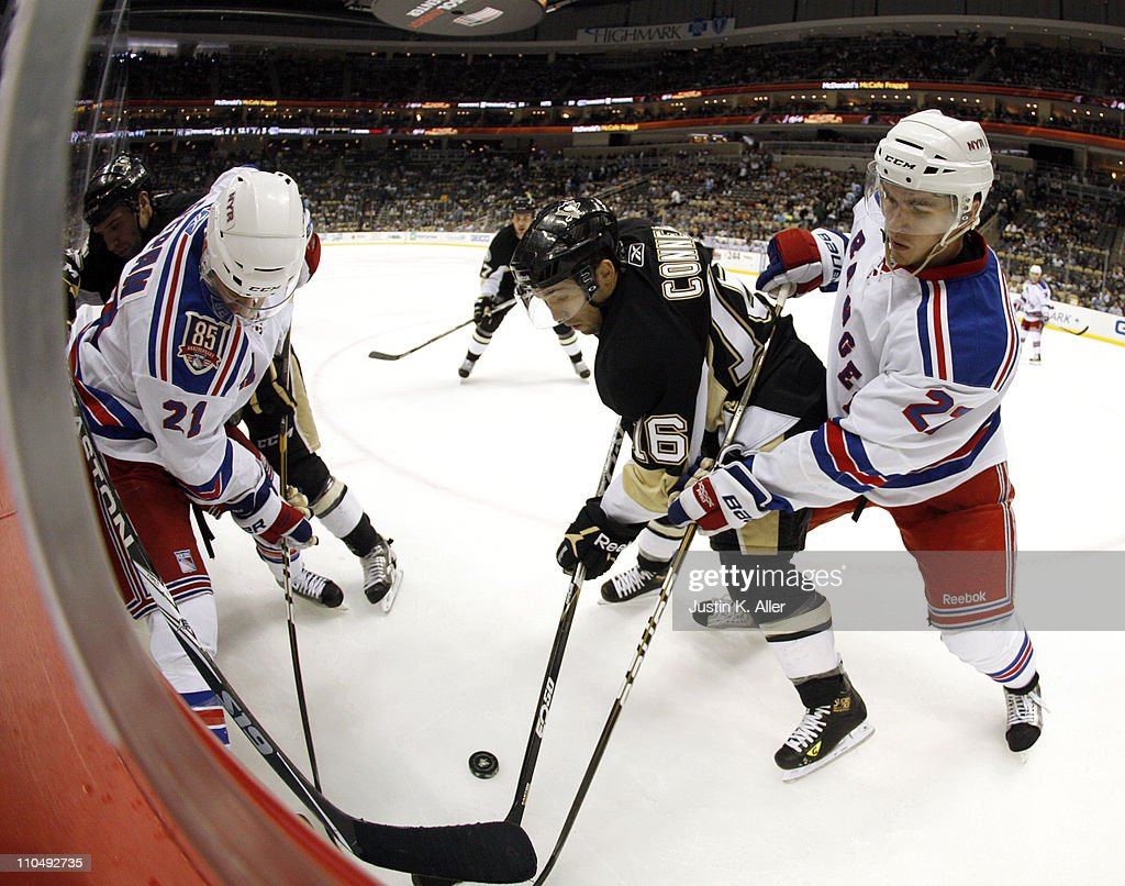 Chris Conner #16 of the Pittsburgh Penguins battles for a puck against Ryan McDonagh #27 and Derek Stepan #21 of the New York Rangers at Consol Energy Center on March 20, 2011 in Pittsburgh, Pennsylvania. The Rangers defeated the Penguins 5-2.