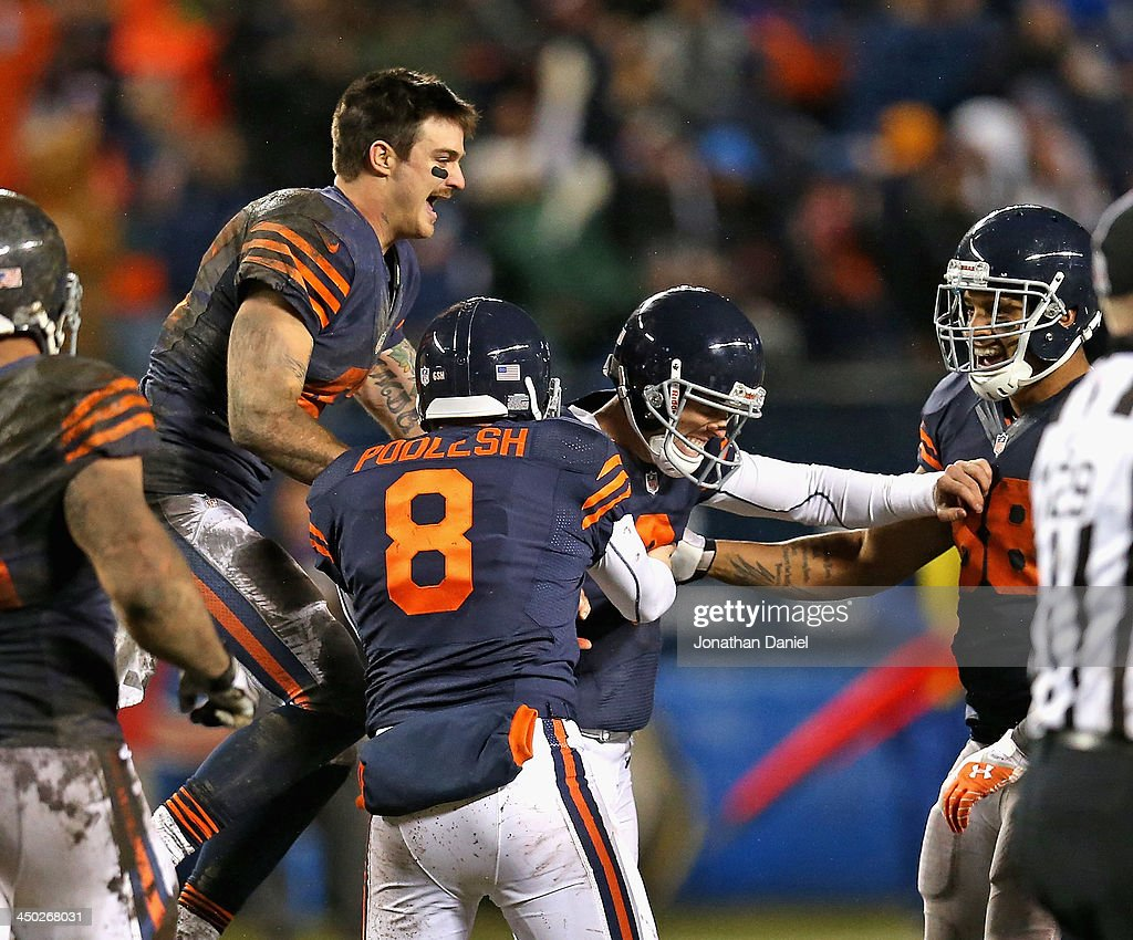 Chris Conte #43, Adam Podlesh #8, Robbie Gould #9 and Dante Rosario #88 of the Chicago Bears celebrate Gould's game-winning 38 yard field goal against the Baltimore Ravens at Soldier Field on November 17, 2013 in Chicago, Illinois. The Bears defeated the Ravens 23-20 in overtime.