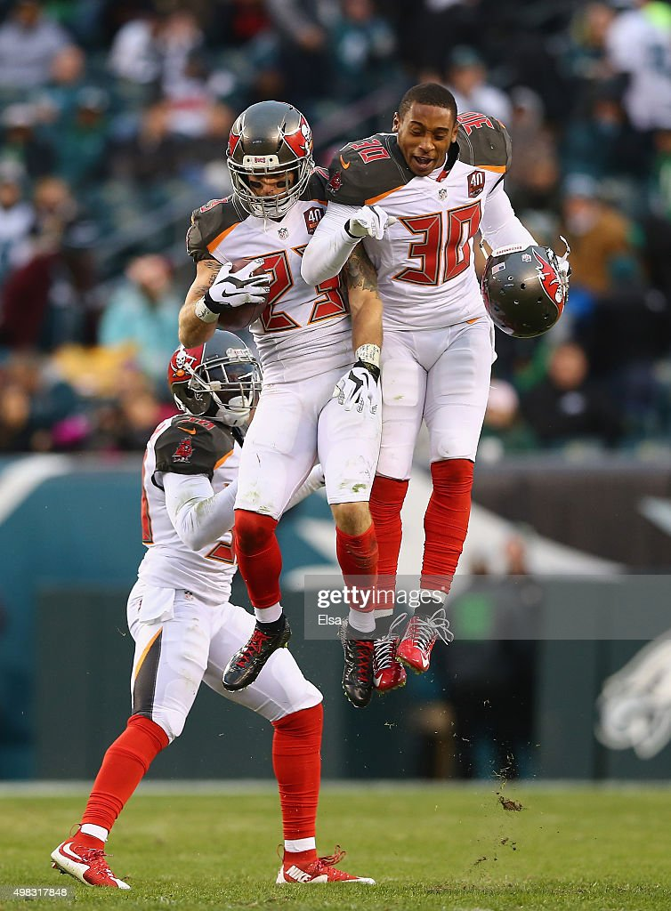 Chris Conte #23 of the Tampa Bay Buccaneers celebrates his interception thrown my quarterback Mark Sanchez #3 (not pictured) of the Philadelphia Eagles with teammate Bradley McDougald #30 the fourth quarter at Lincoln Financial Field on November 22, 2015 in Philadelphia, Pennsylvania.