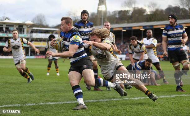 Chris Cook of Bath breaks clear of Tommy Taylor during the Aviva Premiership match between Bath and Wasps at the Recreation Ground on March 4 2017 in...