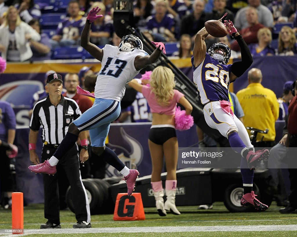 Chris Cook #20 of the Minnesota Vikings breaks up a touchdown pass intended for Kendall Wright #13 of the Tennessee Titans during the fourth quarter of the game on October 7, 2012 at Mall of America Field at the Hubert H. Humphrey Metrodome in Minneapolis, Minnesota. The Vikings defeated the Titans 30-7.