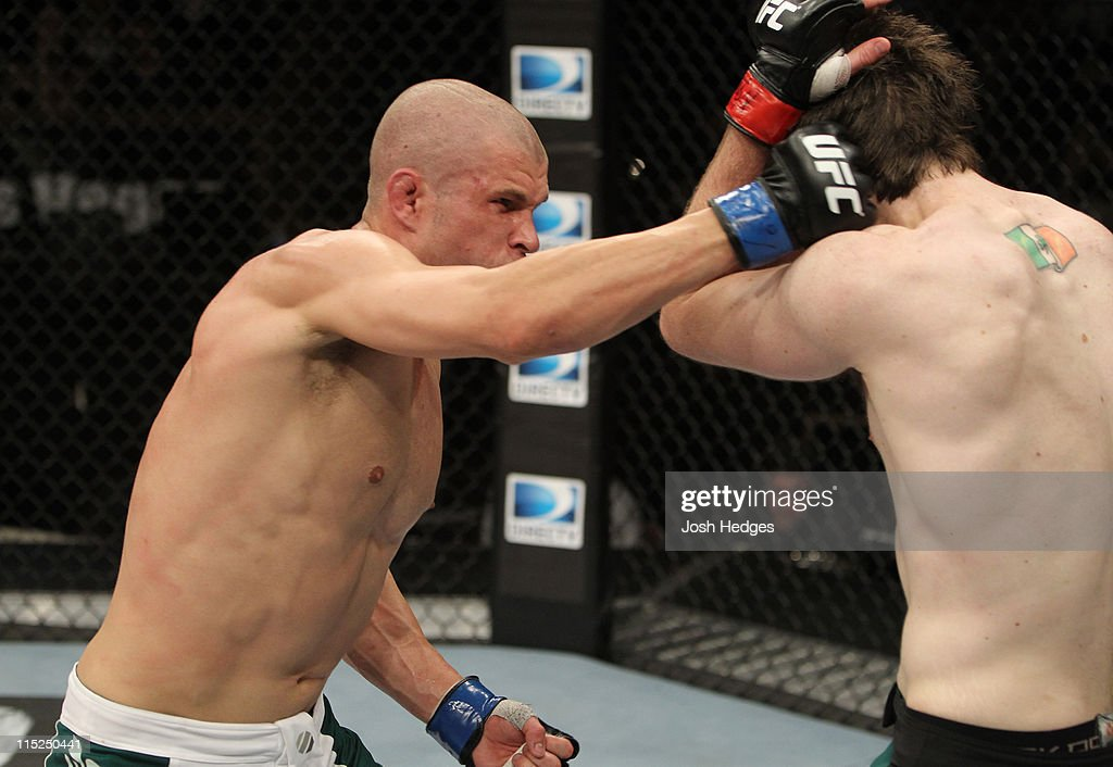Chris Cope punches Chuck O'Neil during their welterweight fight at the Ultimate Fighter Season 13 Finale at the Pearl at the Palms on June 4, 2011 in Las Vegas, Nevada.