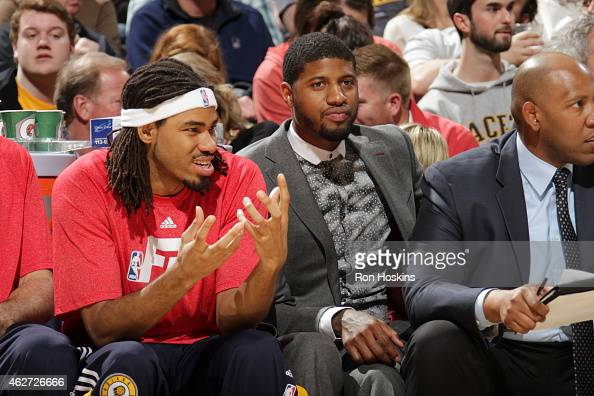 Chris Copeland and Paul George of the Indiana Pacers sit on the sideline during a game against the New York Knicks on January 29 2015 at Bankers Life...