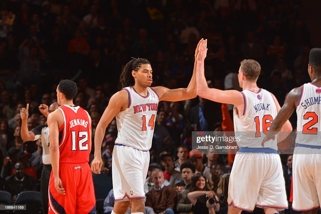 Chris Copeland #14 and Steve Novak #16 of the New York Knicks high-five during their game against the Atlanta Hawks on April 17, 2013 at Madison Square Garden in New York City, New York.