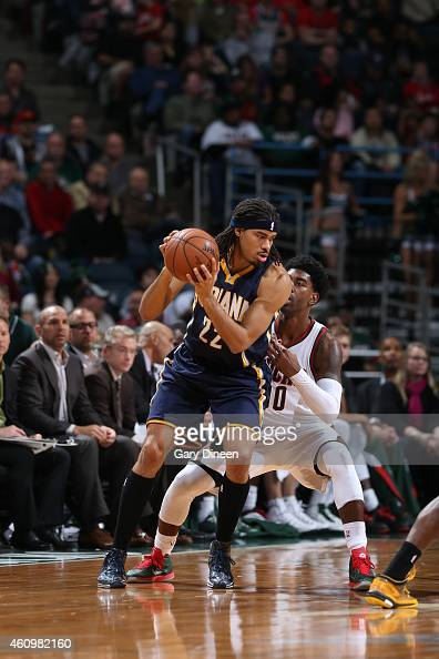 Chris Copeland of the Indiana Pacers handles the ball against OJ Mayo of the Milwaukee Bucks on January 2 2015 at the BMO Harris Bradley Center in...