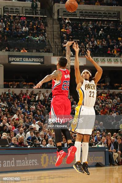 Chris Copeland of the Indiana Pacers shoots against Matt Barnes of the Los Angeles Clippers on December 10 2014 at Bankers Life Fieldhouse in...