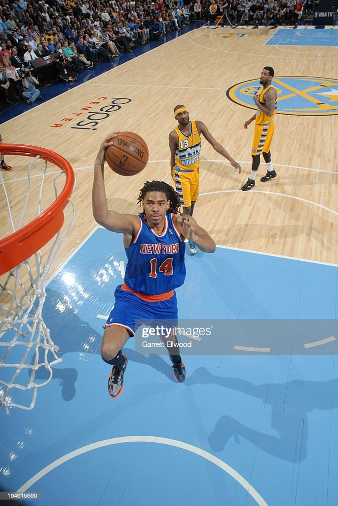 <a gi-track='captionPersonalityLinkClicked' href=/galleries/search?phrase=Chris+Copeland&family=editorial&specificpeople=833969 ng-click='$event.stopPropagation()'>Chris Copeland</a> #14 of the New York Knicks drives to the basket against the Denver Nuggets on March 13, 2013 at the Pepsi Center in Denver, Colorado.