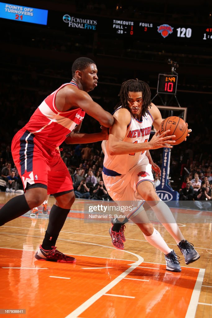 Chris Copeland #14 of the New York Knicks drives to the basket against Kevin Seraphin #13 of the Washington Wizards on April 9, 2013 at Madison Square Garden in New York City.