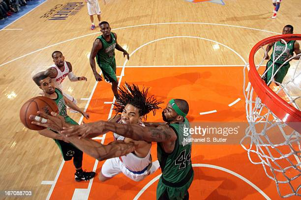 Chris Copeland of the New York Knicks goes up to the basket against Chris Wilcox of the Boston Celtics on March 31 2013 at Madison Square Garden in...