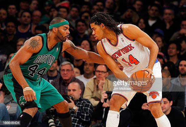 Chris Copeland of the New York Knicks in action against Chris Wilcox of the Boston Celtics at Madison Square Garden on March 31 2013 in New York City...