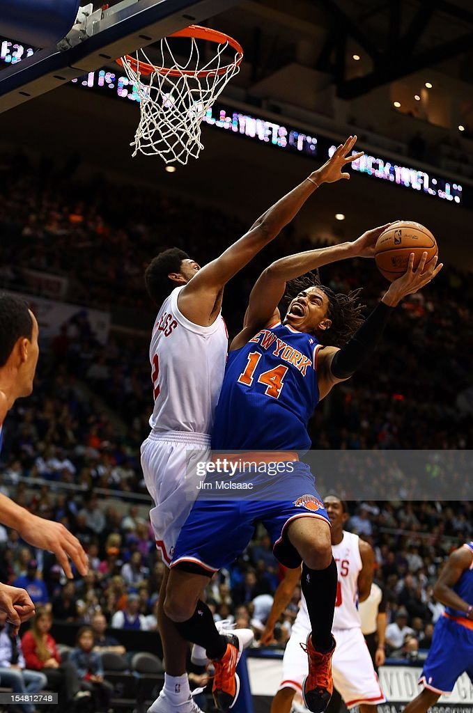 Chris Copeland #14 of the New York Knicks in action against Josh Childress #2 of the Brooklyn Nets during a preseason game at Nassau Coliseum on October 24 2012 in Uniondale, New York The Knicks defeated the Nets 97-95.