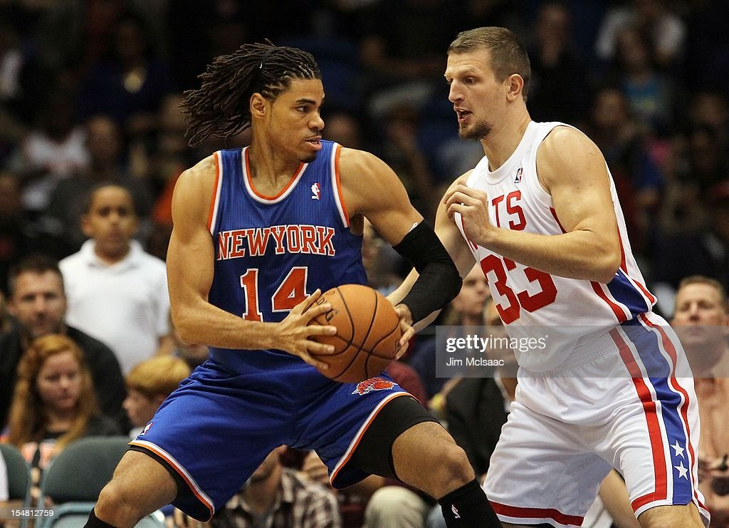 Chris Copeland #14 of the New York Knicks in action against Mirza Teletovic #33 of the Brooklyn Nets during a preseason game at Nassau Coliseum on October 24 2012 in Uniondale, New York The Knicks defeated the Nets 97-95.