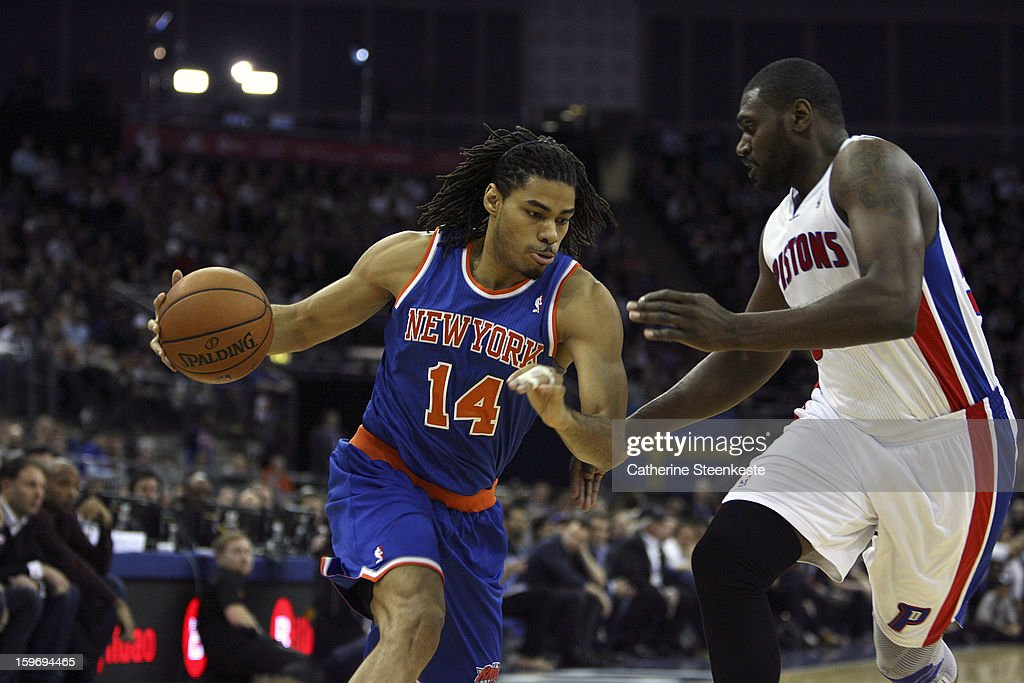 Chris Copeland #14 of the New York Knicks is trying to go to the basket against Jason Maxiell #54 of the Detroit Pistons during a game between New York Knicks and the Detroit Pistons at the O2 Arena on January 17, 2013 in London, England.