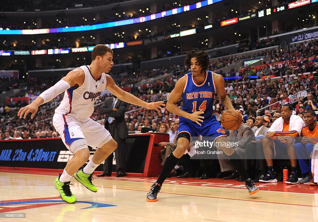Chris Copeland #14 of the New York Knicks protects the ball from Blake Griffin #32 of the Los Angeles Clippers during the game between the Los Angeles Clippers and the New York Knicks at Staples Center on March 17, 2013 in Los Angeles, California.