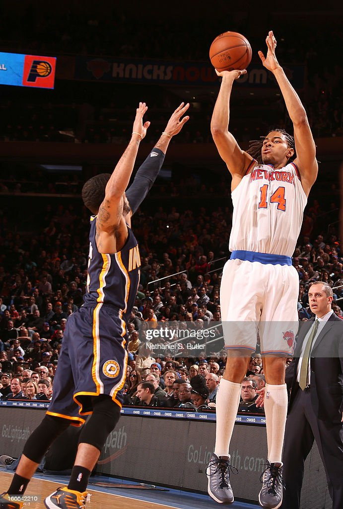 Chris Copeland #14 of the New York Knicks shoots against D.J. Augustin #14 of the Indiana Pacers on April 14, 2013 at Madison Square Garden in New York City.