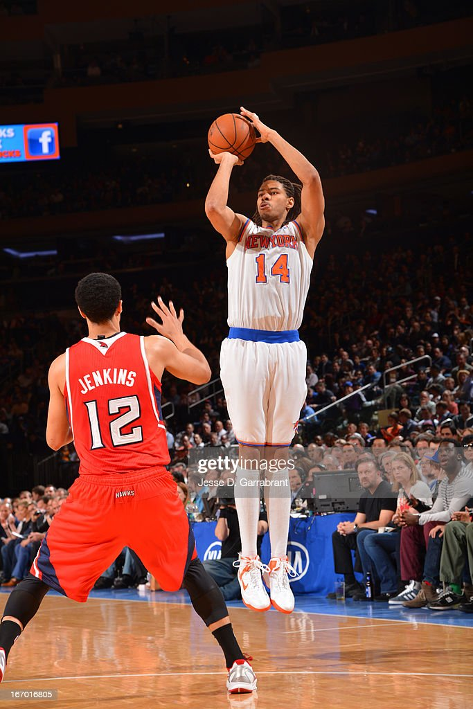 Chris Copeland #14 of the New York Knicks shoots the ball against John Jenkins #12 of the Atlanta Hawks on April 17, 2013 at Madison Square Garden in New York City, New York.