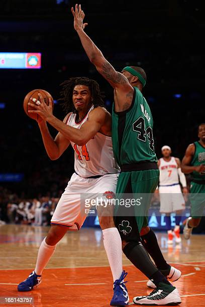 Chris Copeland of the New York Knicks tries to get around Chris Wilcox of the Boston Celtics on March 31 2013 at Madison Square Garden in New York...