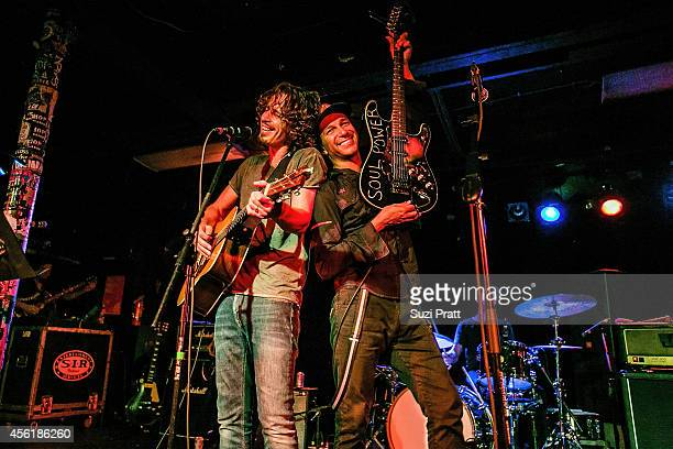Chris Cornell and Tom Morello perform together for the '15 Now' Benefit Show at El Corazn on September 26 2014 in Seattle Washington