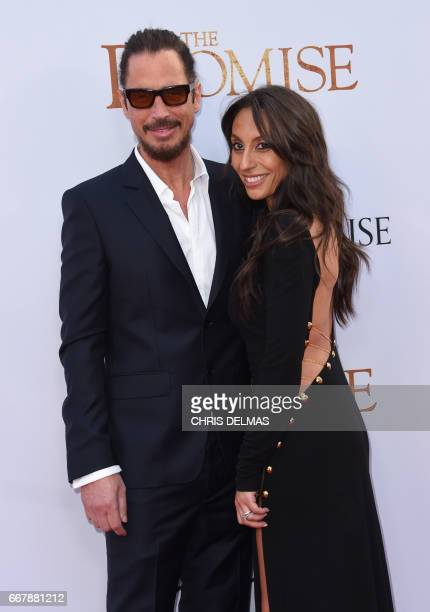 Chris Cornell and Vicky Karayiannis attend the premiere of 'The Promise' at the Chinese theatre in Hollywood on April 12 2017 / AFP PHOTO / CHRIS...