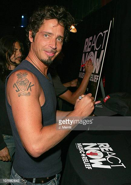 Chris Cornell of Audioslave signs items for auction in MTV VH1 CMT's ReAct Now Music Relief greenroom For more information about ReAct Now Music...