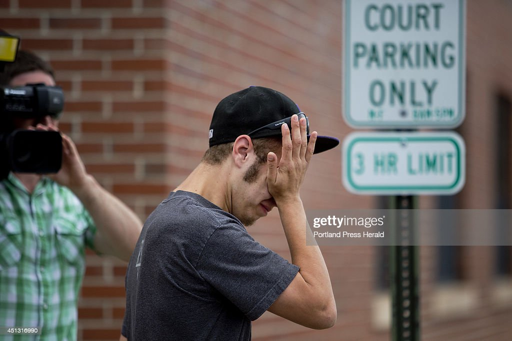 Chris Cote, 19, of Dover, breaks down in tears outside district court in Dover, N.H. after watching the arraignment of Madbury, N.H., Zachary Pinette, 18, of Springvale, Michael Tatum, 21, of Barrington, N.H., on charges of first degree murder for causing the death of Aaron Wilkinson, 18, of Madbury, N.H. Cote was good friends with Wilkinson, whose body was found in Lebanon, Maine.