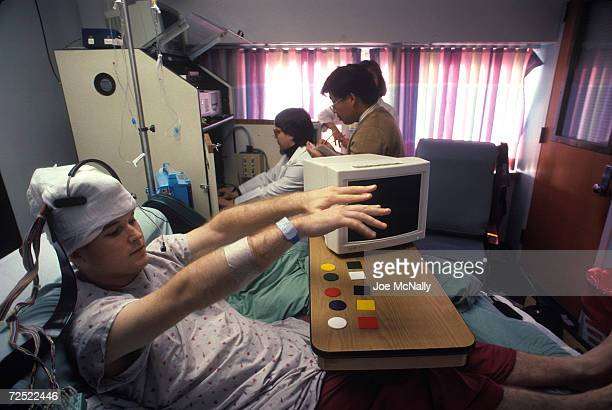 UNDATED Chris Cotter undergoes testing after brain surgery in which a grid of electrodes was implanted in his brain to determine the source of his...