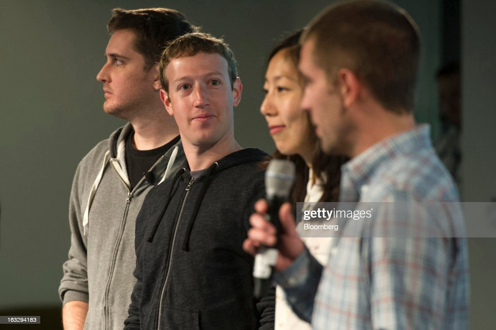 Chris Cox, vice president of product for Facebook Inc., right, speaks as Tech Lead Chris Struhar, from left, Chief Executive Officer Mark Zuckerberg, Director of Design Julie Zhuo listen during an event at the company's headquarters in Menlo Park, California, U.S., on Thursday, March 7, 2013. Mark Zuckerberg, chief executive officer and founder of Facebook Inc., discussed the social-network site's upgraded News Feed which includes bigger photos, information sorted into topics and a more consistent design across devices. Photographer: David Paul Morris/Bloomberg via Getty Images
