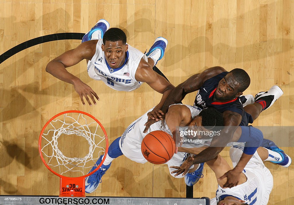 Chris Crawford #3 and Nick King #5 of the Memphis Tigers jump for a rebound against Sam Dower Jr. #35 of the Gonzaga Bulldogs on February 8, 2014 at FedExForum in Memphis, Tennessee. Memphis beat Gonzaga 60-54.