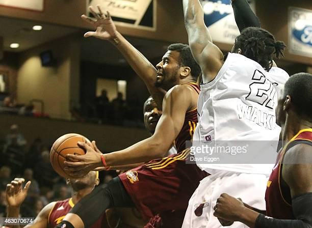 Chris Crawford from the Canton Charge takes the ball to the basket between a pair of defenders including Henry Walker from the Sioux Falls Skyforce...