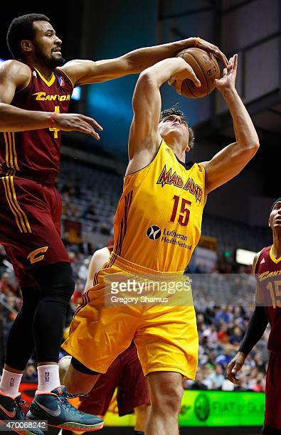 Chris Crawford of the Canton Charge blocks the shot of Matt Bouldin of the Fort Wayne Mad Ants during Game 1 of the Eastern Conference NBDL playoffs...