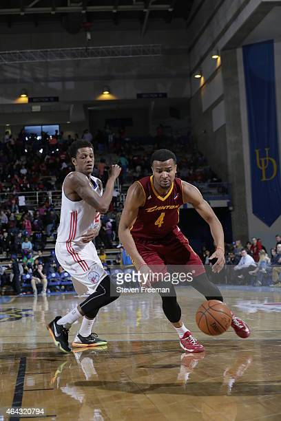 Chris Crawford of the Canton Charge drives against Jamal Jones of the Delaware 87ers at the University of Delaware Bob Carpenter Center on February...