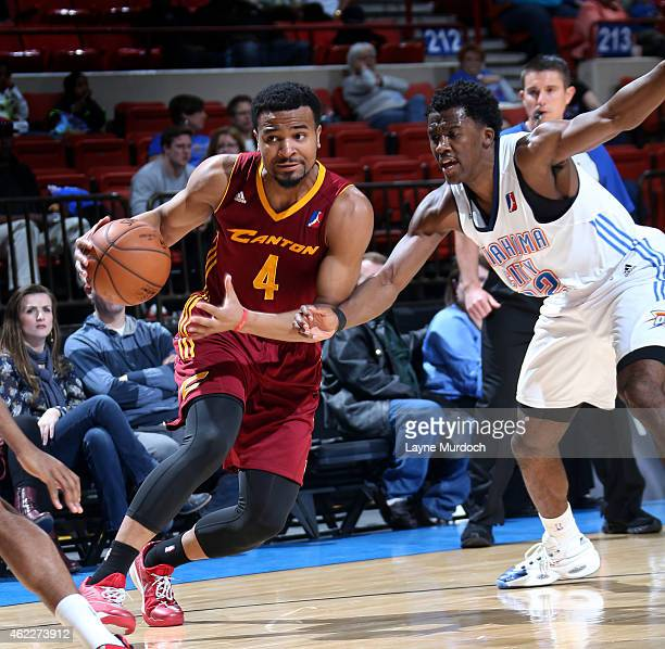 Chris Crawford of the Canton Charge drives the ball against Semaj Christon of the Oklahoma City Blue during an NBA DLeague game on January 23 2015 at...