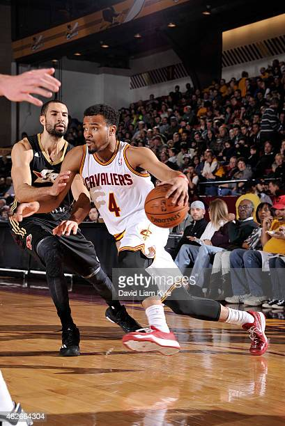 Chris Crawford of the Canton Charge drives to the basket against Drew Crawford of the Erie BayHawks at the Canton Memorial Civic Center on January 31...