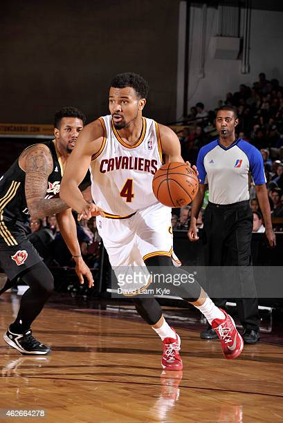 Chris Crawford of the Canton Charge drives to the basket against the Erie BayHawks at the Canton Memorial Civic Center on January 31 2015 in Canton...
