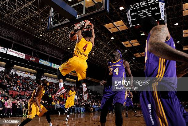 Chris Crawford of the Canton Charge dunks the ball against Ater Majok of the Los Angeles DFenders at the Canton Memorial Civic Center on December 30...
