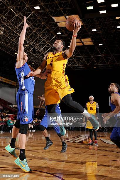 Chris Crawford of the Canton Charge goes up for the shot against Ben Strong of the Westchester Knicks at the Canton Memorial Civic Center on March 17...