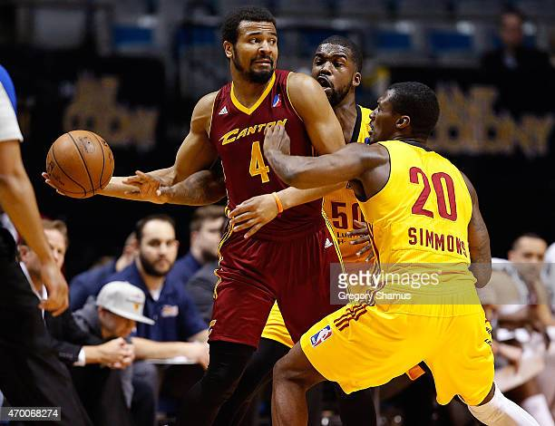 Chris Crawford of the Canton Charge looks to pass the ball while guarded by Marcus Simmons and Travis Hyman of the Fort Wayne Mad Ants during Game 1...