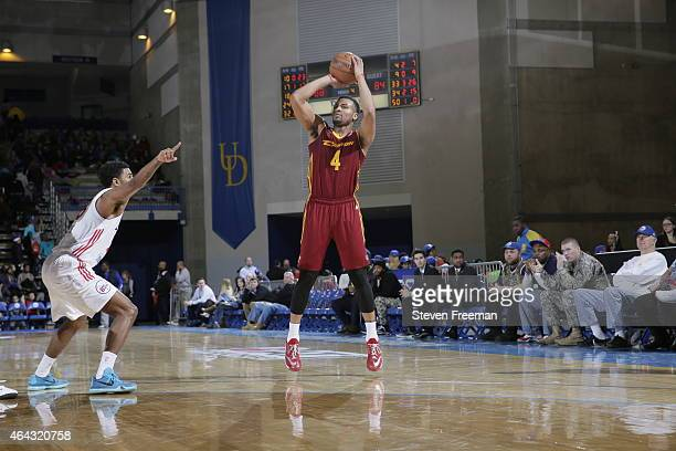 Chris Crawford of the Canton Charge shoots against DJ Seeley of the Delaware 87ers at the University of Delaware Bob Carpenter Center on February 24...