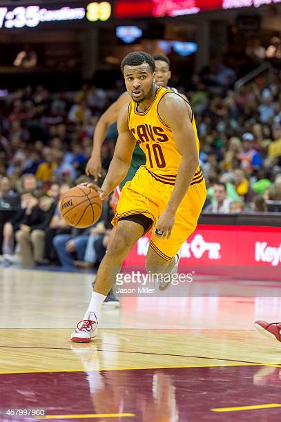 Chris Crawford of the Cleveland Cavaliers drives into the paint during the second half against the Milwaukee Bucks at Quicken Loans Arena on October...