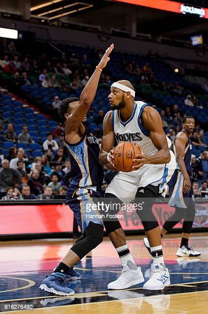 Chris Crawford of the Memphis Grizzlies guards against Adreian Payne of the Minnesota Timberwolves during the preseason game on October 19 2016 at...