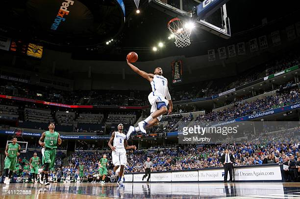 Chris Crawford of the Memphis Tigers goes up for a dunk against the Marshall Thundering Herd during the Championship of the 2012 CUSA men's...