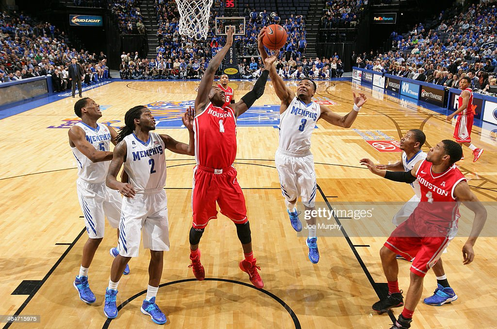 Chris Crawford #3 of the Memphis Tigers grabs a rebound against Mikhail McLean #1 of the Houston Cougars on January 23, 2014 at FedExForum in Memphis, Tennessee. Memphis beat Houston 82-59.