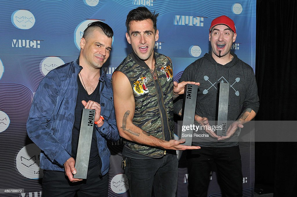 Chris Crippin, Jacob Hoggard and Tommy Mac of Hedley pose in the press room at the 2014 MuchMusic Video Awards at MuchMusic HQ on June 15, 2014 in Toronto, Canada
