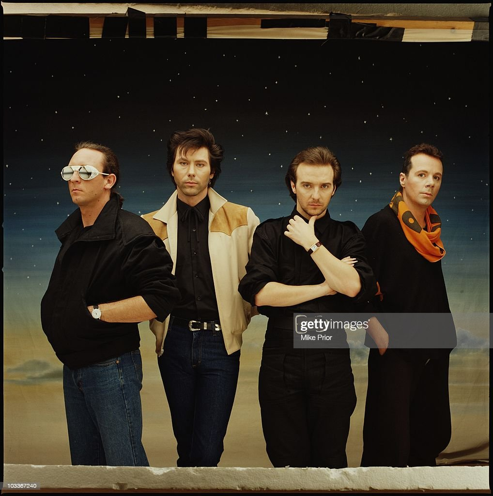 Chris Cross Warren Cann Midge Ure and Billy Currie of Ultravox pose for a studio group portrait in 1984 in London