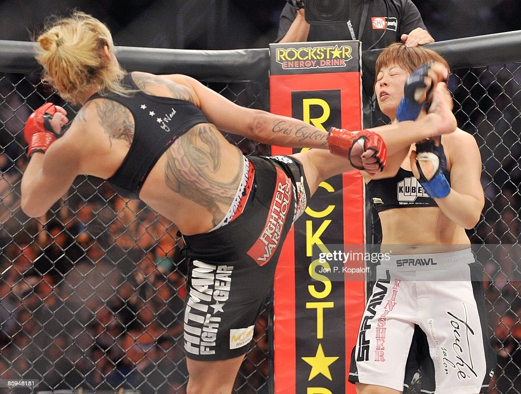 Chris 'Cyborg' Santos (L) battles Hitomi Akano at Strikeforce: Shamrock vs. Diaz at HP Pavilion on April 11, 2009 in San Jose, California.