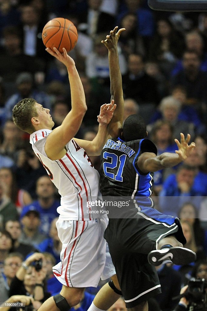 Chris Czerapowicz #35 of the Davidson Wildcats puts up a shot against Amile Jefferson #21 of the Duke Blue Devils at Time Warner Cable Arena on January 2, 2013 in Charlotte, North Carolina. Duke defeated Davidson 67-50.
